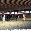 A mounted drill team in the indoor arena